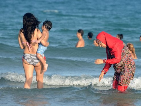 A woman wears a burkini on a beach in Tunisia. Photograph: Fethi Belaid/AFP/Getty Images